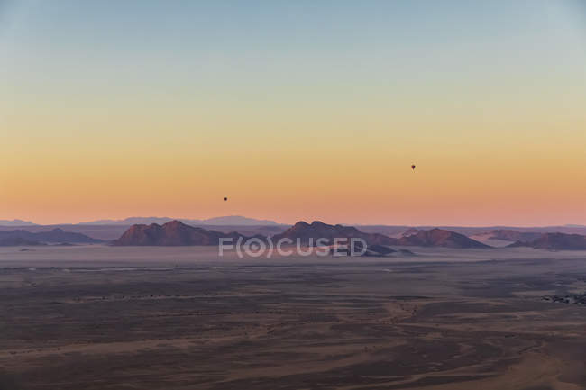 Africa, Namibia, Namib desert, Namib-Naukluft National Park, Aerial view of desert dunes in the morning light, air ballons — Stock Photo