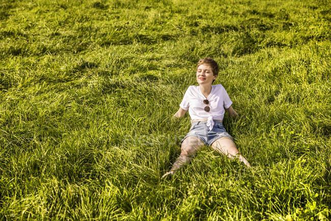 Woman in field enjoying sunlight — Stock Photo