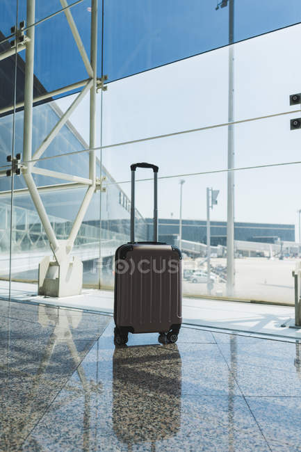 Suitcase at airport at daytime — Stock Photo