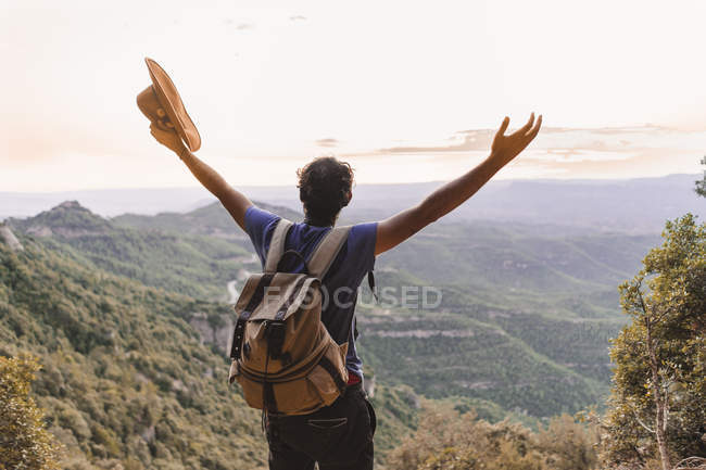 Spain, Barcelona, Montserrat, back view of hiker with backpack looking at view — Stock Photo