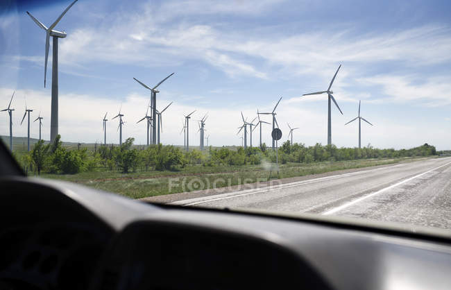 UK, Scotland, wind turbines seen from car — Stock Photo