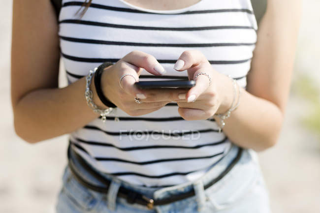 Close-up of woman using a cell phone — Stock Photo