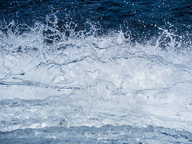 Full frame image of blue water splashes — Stock Photo