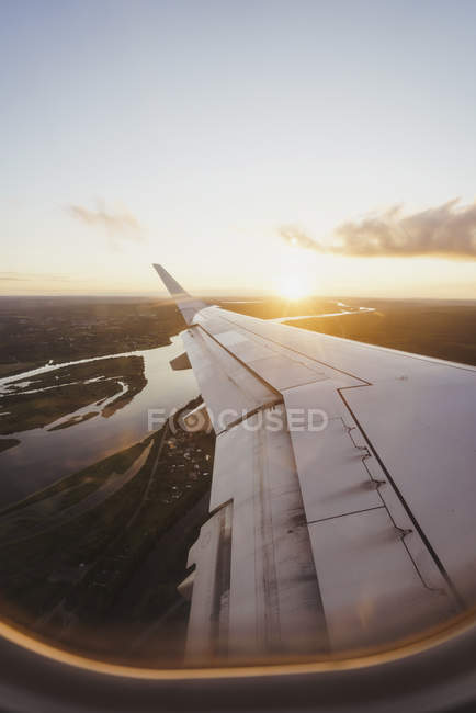 View out of window on wing of a plane at sunset — Stock Photo