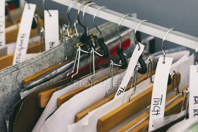 Clothes rail in tailor shop — Stock Photo
