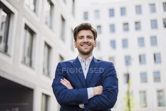 Portrait of confident businessman standing in city — Stock Photo