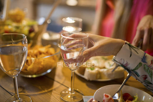 Close-up of friends having dinner at home — Stock Photo