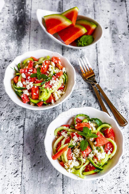 Two bowls of salad with watermelon, cucumber, feta and mint — Stock Photo