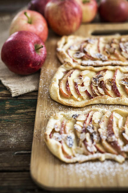 Home-baked Apple Pie on wooden board — Stock Photo