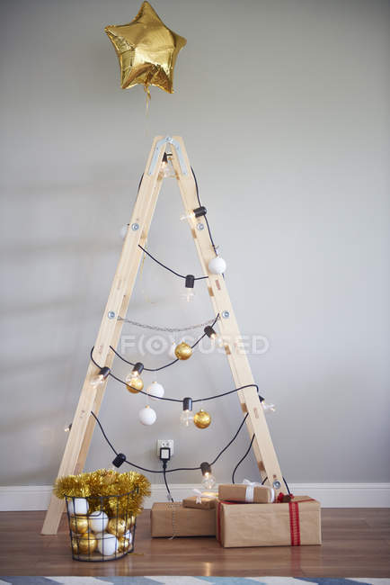 Christmas tree made from ladder — Stock Photo