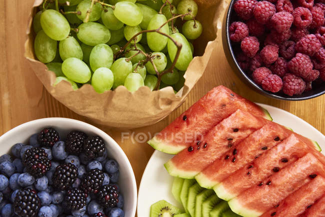 Fresh fruits on table, top view — Stock Photo