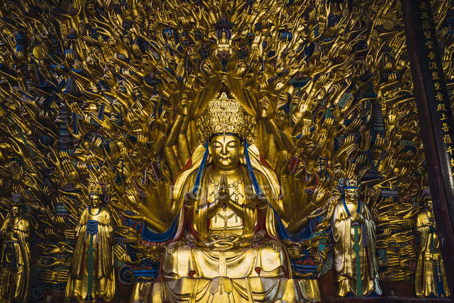 China, Sichuan Province, Dazu Rock Carvings, golden Buddha statue — Stock Photo