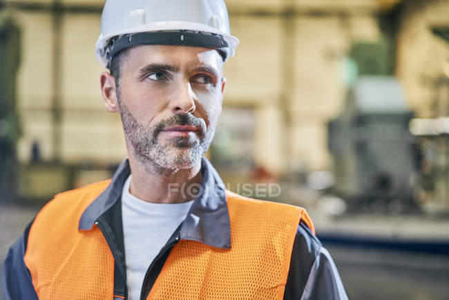 Portrait of man in factory looking away — Stock Photo