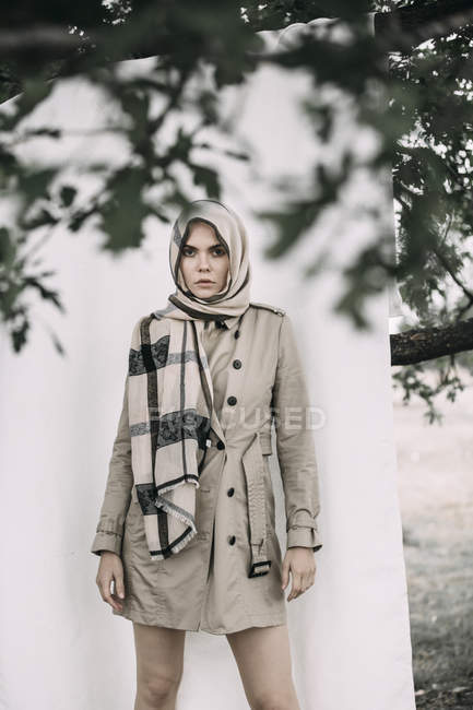 Portrait of fashionable model woman wearing coat and scarf — Stock Photo
