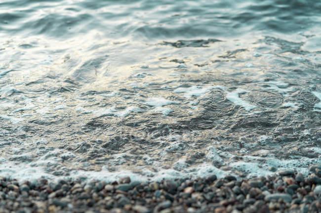 Spain, Catalonia, Costa Brava, stony beach, seafront — Stock Photo