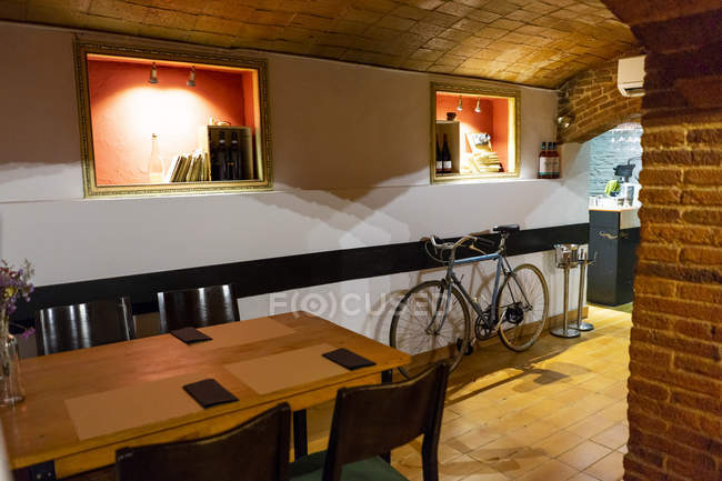 Interior of a restaurant with bicycle inside — Stock Photo