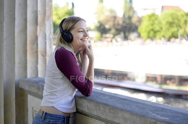 Young blond woman with earphones — Stock Photo