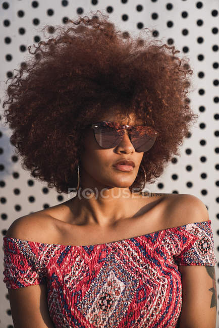 Portrait of fashionable woman wearing mirrored sunglasses — Stock Photo