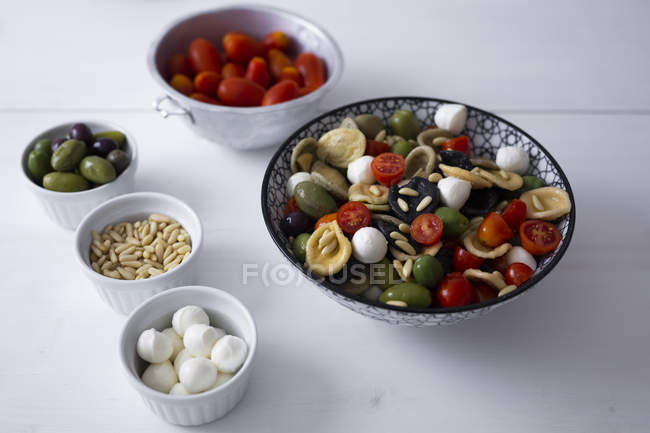 Mediterranean orecchiette with tomato, olives, mozzarella — Stock Photo