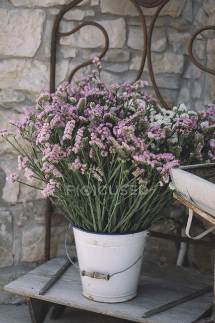 Fresh flowers in busket — Stock Photo