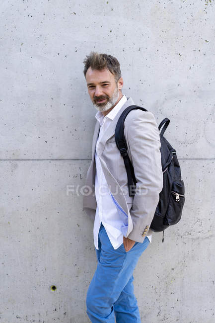 Portrait of casual businessman with backpack — Stock Photo