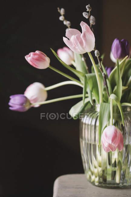 Fresh tulips in vase — Stock Photo