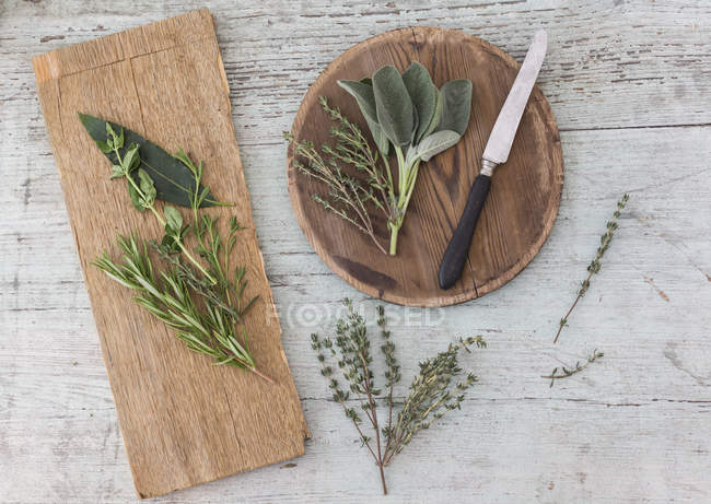 Fresh Provencal herbs, knife and   wooden boards — Stock Photo