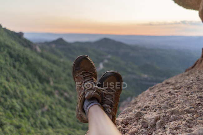 Spain, Barcelona, Montserrat, feet of resting man, hiking shoes — Stock Photo