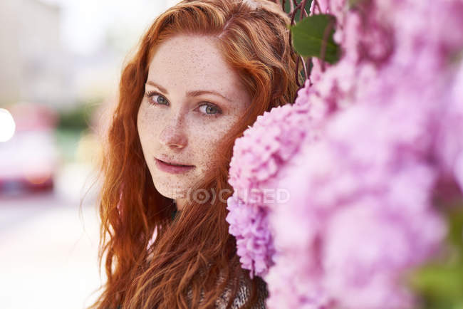 Portrait of redheaded woman with freckles — Stock Photo