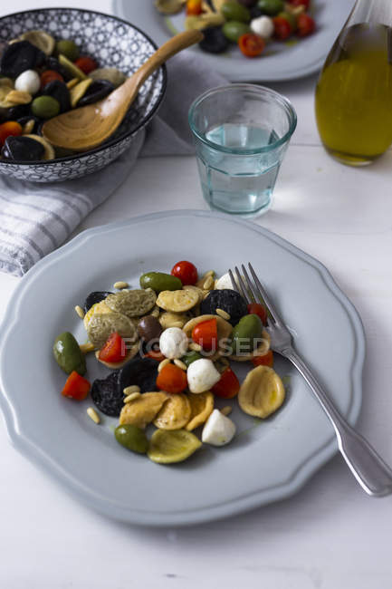 Mediterranean orecchiette with tomatoes, olives, mozzarella — Stock Photo