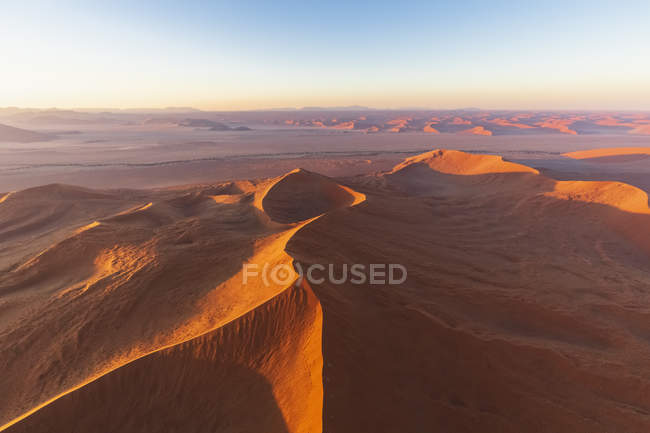 Africa, Namibia, Namib desert, Namib-Naukluft National Park, Aerial view of desert dunes in the morning light — Stock Photo