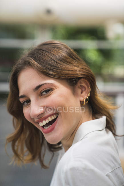 Portrait of laughing young woman in greenhouse — Stock Photo