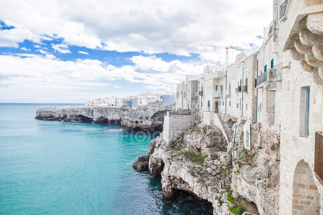 Italy, Puglia, Polognano a Mare, view of historic old town at seaside — Stock Photo