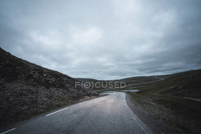 Norway, Lapland, North Cape, Winding road through the hills — Stock Photo