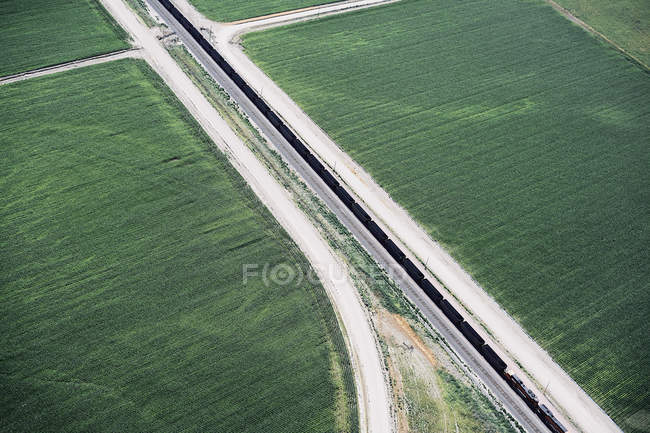 USA, Aerial of canal and farm roads dividing fields in Western Nebraska — Stock Photo