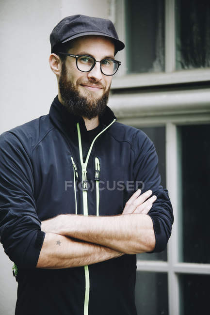 Portrait of smiling man wearing cap and glasses — Stock Photo