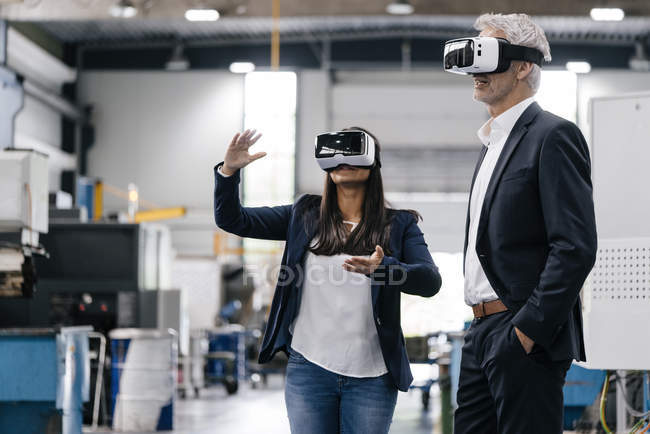 Business people in high-tech enterprise, using VR glasses — Stock Photo