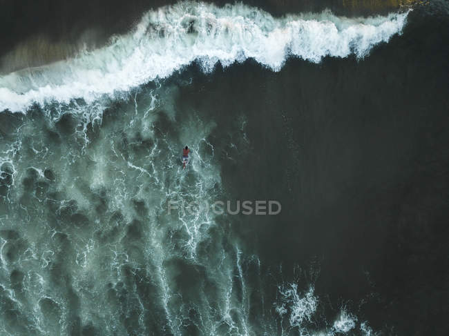 Indonesia, Bali, Aerial view of surfer in the ocean — Stock Photo