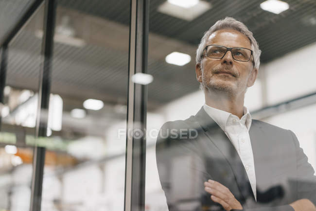 Portrait of successful entrepreneur thinking in company — Stock Photo