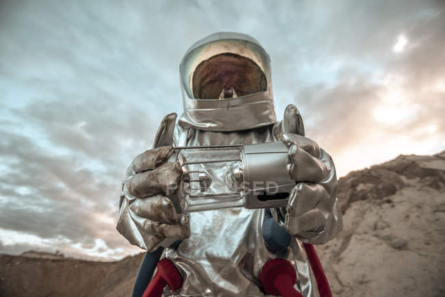Spaceman exploring nameless planet, holding analyzer — Stock Photo
