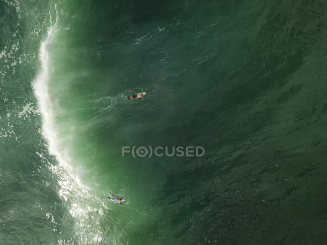 Indonesia, Bali, Aerial view of surfers in the ocean — Stock Photo