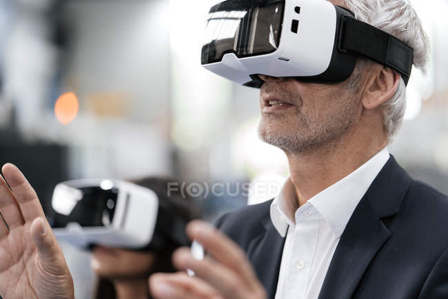 Portrait of successful entrepreneur in company using vr glasses — Stock Photo