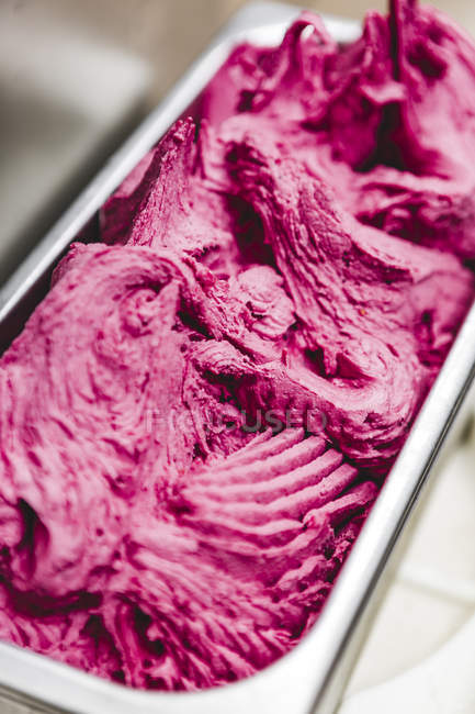Close up of pink Ice cream in container — Stock Photo