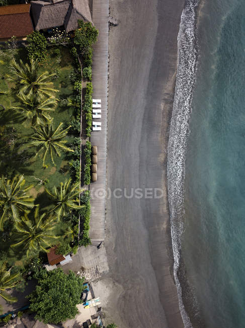Indonesia, Bali, Aerial view of beach with empty sun loungers — Foto stock