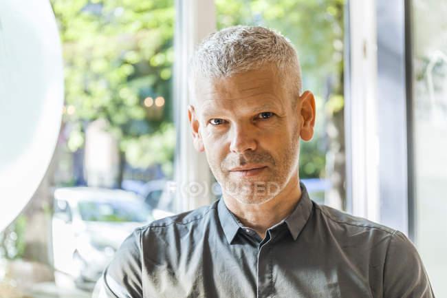 Portrait of confident mature man wearing green shirt — Stock Photo