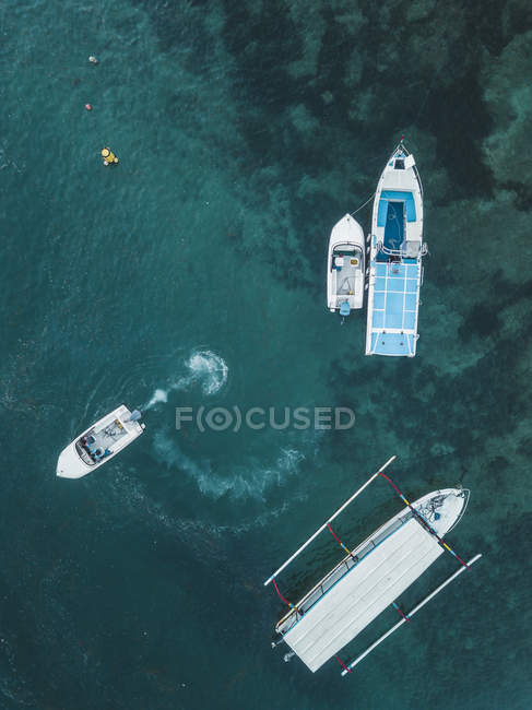 Indonesia, Bali, Aerial view of motorboats from above — Stock Photo