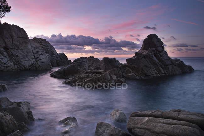 Spain, Catalonia, Lloret de Mar, Cala Trons at twilight — Stock Photo