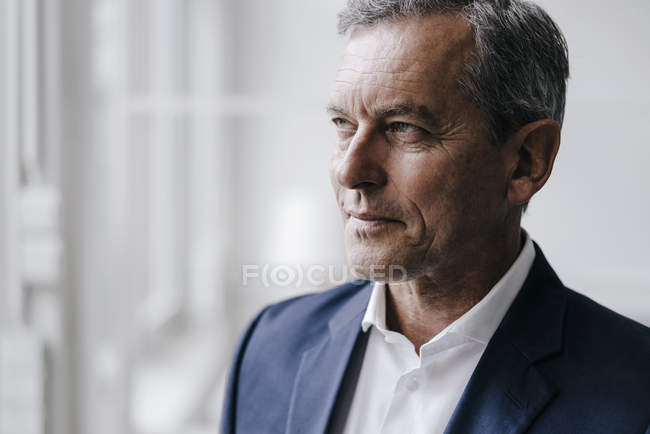 Portrait of confident mature businessman looking away — Stock Photo