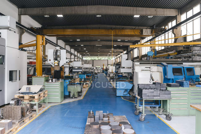 Interior of factory workshop with blue floor — Stock Photo
