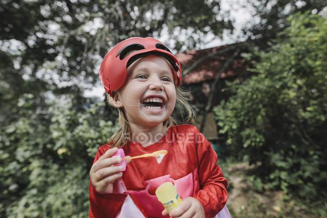 Portrait of laughing masqueraded little girl having fun — Photo de stock